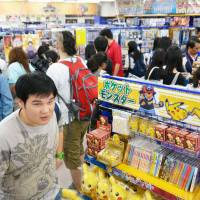The Bangkok branch of animate, an anime and manga retail chain, which opened on Saturday, is seen crowded with shoppers. | KYODO
