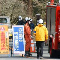 Roads near Mount Io in Ebino, Miyazaki Prefecture, are closed off to traffic Sunday after the Meteorological Agency warned the volcano might have a small eruption. | KYODO