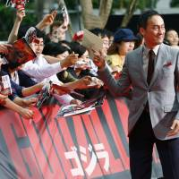 Japanese actor Ken Watanabe signs autographs in 2014 for fans at the Japan premiere of his movie 'Godzilla' in Tokyo. Watanabe, one of a handful of Japanese actors who has made it on the international stage, underwent surgery for stomach cancer. But he has beaten serious sickness before, having had leukemia more than 20 years ago. The early-stage cancer was found in a medical checkup, the Tony- and Oscar-nominated actor said on his Japanese Twitter account. | AP