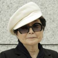 Yoko Ono hospitalized for flu symptoms but on the mend, agent says
