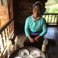 In Hoa Binh, Bui Thi Thuong, a member of the Muong ethnic minority, displays indigenous seeds she has gathered for preservation.   COURTESY OF MAYU INO
