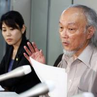 Not what you think: Hisao Seto, a lawyer representing an 82-year-old Chinese permanent resident, speaks in Tokyo after the Supreme Court ruled in July 2014 that the plaintiff couldn't appeal her rejected application for welfare support from the city of Oita. | KYODO