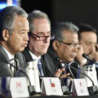 Tough sell: Then-trade minister Akira Amari speaks at a news conference after reaching agreement on the Trans-Pacific Partnership with other Pacific Rim nations in Atlanta in October 2015. | KYODO