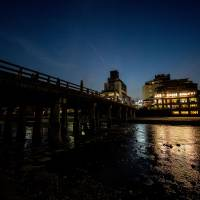 On a night stroll in Kyoto, past Sanjo Ohashi and the Kamo River. | BENJAMIN PARKS
