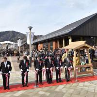 Starting fresh: The ribbon is cut at Seapal Pia, the new shopping street in Onagawa, Miyagi Prefecture. The street is named after Seapal, a local mascot. | KYODO