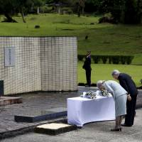 Honoring the fallen: Japan's Emperor Akihito and Empress Michiko bow their heads while paying tribute to Japanese soldiers who fought in World War II, at a memorial shrine in Cavinti, the Philippines.  | REUTERS