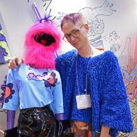 Designer Brandon Reierson poses with one of his designs at the Rooms fashion and lifestyle trade fair in Tokyo. | SAMUEL THOMAS