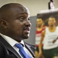 Athletics Kenya CEO Isaac Mwangi has been accused of asking two runners who are serving doping bans to pay bribes to reduce their suspensions. | AP