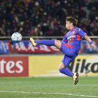Hiroki Kawano scores FC Tokyo's seventh goal in a 9-0 rout of Chonburi FC in an Asian Champions League playoff on Tuesday at Ajinomoto Stadium. | KYODO