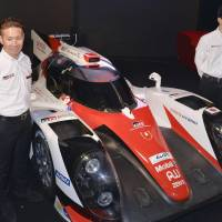 Former Formula One driver Kamui Kobayashi (left) is introduced as a full-time driver on Toyota's World Endurance Championship team on Thursday, marking his first entry into the premier class of endurance road racing. | KYODO