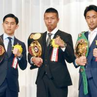 World champions Takashi Uchiyama (center), Kazuto Ioka (left) and  Shinsuke Yamanaka on Friday received awards in recogntion of their accomplishments as top Japanese boxers in 2015. | KYODO