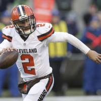 Cleveland Browns QB Johnny Manziel's life appears to be spiraling out of control and has his family members concerned. | AP
