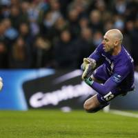 Manchester City's Willy Caballero saves a shot from Liverpool's Philippe Coutinho on Sunday. | REUTERS