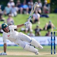 Australian batsman Joe Burns falls after being hit on the helmet during the fifth day of the second test against New Zealand on Wednesday. | AFP-JIJI