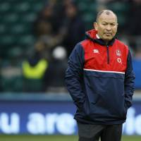 England coach Eddie Jones walks on the Twickenham pitch before his team's Six Nations match against Ireland on Saturday. | AP
