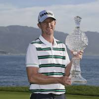 Vaughn Taylor poses with his trophy after winning the AT&T Pebble Beach Pro-Am on Sunday in Pebble Beach, California. | AP