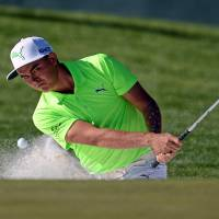 Rickie Fowler plays out of the 16th bunker in Scottsdale, Arizona, earlier this month. | USA TODAY / REUTERS