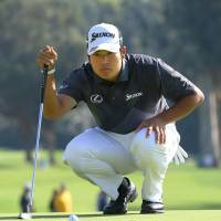 Hideki Matsuyama lines up a putt during the third round of the Northern Trust Open on Saturday. | KYODO