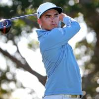 Rickie Fowler tees off on the 14th hole during the second round of the Honda Classic on Friday. Fowler carded a 66 and leads by one stroke. | USA TODAY / REUTERS