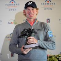 Brandt Snedeker poses with the winner's trophy following his Farmers Insurance Open victory at Torrey Pines on Monday. | USA TODAY / REUTERS