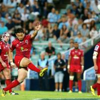 The Reds' Ayumu Goromaru kicks a penalty against the Waratahs in Sydney on Saturday. | AP