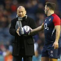England coach Eddie Jones takes the ball from Danny Care before their game against Scotland on Saturday in Edinburgh. England won 15-9. | REUTERS