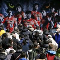 Fans climb the stairs before the Sunwolves-Lions' Super Rugby match on Saturday at Prince Chichibu Memorial Rugby Ground.  | REUTERS