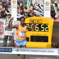 Feyisa Lilesa begins to celebrate as he approaches the finish line during the Tokyo Marathon on Sunday. The race represented Lilesa's first victory in a major marathon. | AFP-JIJI