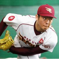 Eagles closer Yuki Matsui pitches in the bullpen during spring camp on Wednesday in Kumejima, Okinawa. | KYODO