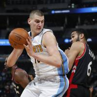 Denver's Nikola Jokic backs in for a shot against Toronto's Cory Joseph in the second half on Monday night. The Nuggets beat the Raptors 112-93. | AP