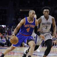 New York's Arron Afflalo drives on Detroit's Stanley Johnson in the second half on Thursday night. The Pistons beat the Knicks 111-105. | AP