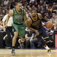 Cleveland's Kyrie Irving drives past Boston's Avery Bradley in the first quarter on Friday night. | USA TODAY / REUTERS