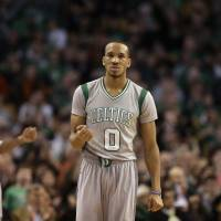 Celtics guard Avery Bradley celebrates during the fourth quarter of Boston's win over the Kings on Sunday. | AP
