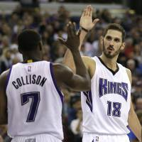 Forward Omri Casspi (right) is averaging 12.3 points and 6.4 rebounds per game this season for the Sacramento Kings. | AP