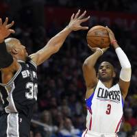 Los Angeles' Chris Paul puts up a jumper over San Antonio's David West in the second half on Thursday night. | AP