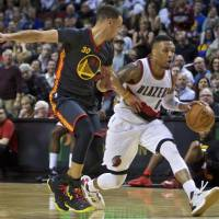 Lillard torches Warriors for 51
