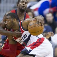 Washington's John Wall drives against New Orleans' Toney Douglas during the Wizards' 109-89 win on Tuesday. | AP
