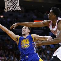 Golden State's Klay Thompson puts up a shot against Miami's Hassan Whiteside in the first half on Wednesday night. | AP