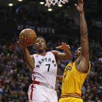 Toronto's Kyle Lowry puts up a shot against Cleveland's Tristan Thompson on Friday night at the Air Canada Centre. The Raptors beat the Cavaliers 99-97. | USA TODAY / REUTERS