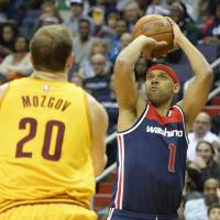 Wizards forward Jared Dudley shoots over the Cavaliers' Timofey Mozgov during their game on Sunday in Washington. | USA TODAY / REUTERS