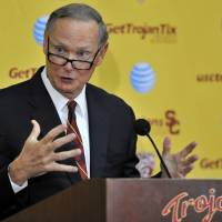 USC athletic director Pat Haden, who was a star quarterback for the Trojans in the 1970s, will step down from his post in June. | AP
