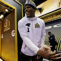 Carolina Panthers QB Cam Newton is introduced during 'Opening Night' for Super Bowl 50 on Monday in San Jose, California. | AP