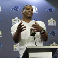 Carolina quarterback Cam Newton answers questions at a Super Bowl 50 news conference on Tuesday. | AP