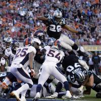 Panthers running back Jonathan Stewart leaps over the pile to score a touchdown during Super Bowl 50 on Sunday. | AP
