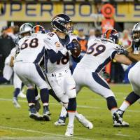Broncos quarterback Peyton Manning drops back to pass against the Panthers on Sunday. | REUTERS
