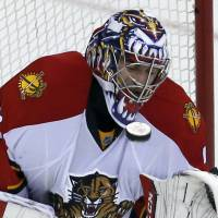 Florida goalie Al Montoya stops the puck with his mask during the Panthers' 5-2 win over the Capitals on Tuesday. | AP