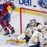 Montreal's Dale Weise scores past Buffalo goalie Robin Lehner in the second period on Wednesday night. | AP