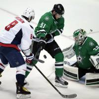 Dallas' Tyler Seguin (center) and goalie Kari Lehtonen defend against Washington's Alex Ovechkin on Saturday. | USA TODAY / REUTERS