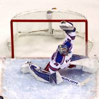New York goalie Henrik Lundqvist makes a glove save against St. Louis in the second period on Thursday night.   AP