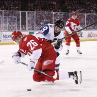 Detroit's Tomas Jurco (26) is knocked down by Colorado's Matt Duchene on Sunday. | USA TODAY / REUTERS